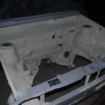 De motor ruimte gespoten in gebroken wit, wat later een mooi contrast zal geven met de rode carrosserie kleur.
